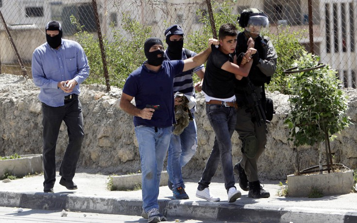 Δεκάδες τραυματίες σε συγκρούσεις Παλαιστινίων και Ισραηλινών - Εικόνα1