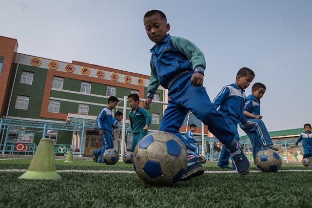 Η ζωή στην  Πιονγιάνγκ: ένα αποκλειστικό φωτορεπορτάζ από το RIA Novosti - Εικόνα11