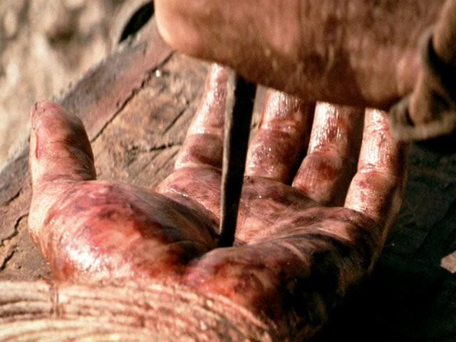 nail-pierced-hand