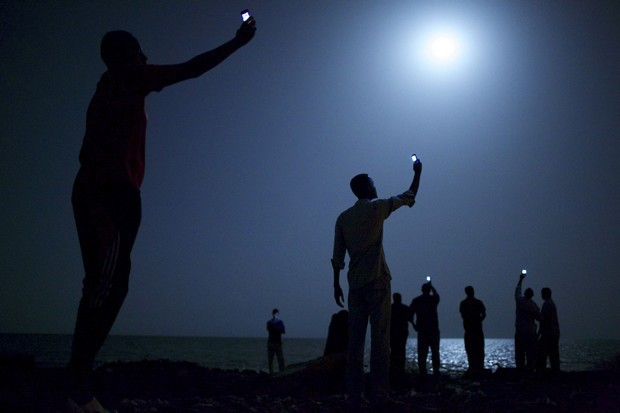 "WORLD PRESS PHOTO CONTEST WINNERS. PICTURE 01 OF 19 John Stanmeyer, a U.S. photographer working for VII agency on assignment for National Geographic, won the World Press Photo of the Year 2013 contest with this picture of African migrants on the shore of Djibouti city at night taken February 26, 2013. The prize-winning entries of the World Press Photo Contest 2014, the world's largest annual press photography contest, were announced February 14, 2014. Jury member Jillian Edelstein said about the winning image: ""It's a photo that is connected to so many other stories-it opens up discussions about technology, globalization, migration, poverty, desperation, alienation, humanity. It's a very sophisticated, powerfully nuanced image. It is so subtly done, so poetic, yet instilled with meaning, conveying issues of great gravity and concern in the world today."" REUTERS/John Stanmeyer/World Press Photo Handout via Reuters  (DJIBOUTI - Tags: MEDIA SOCIETY IMMIGRATION POLITICS TPX IMAGES OF THE DAY) NO COMMERCIAL OR BOOK SALES. NO SALES. NO ARCHIVES. FOR EDITORIAL USE ONLY. NOT FOR SALE FOR MARKETING OR ADVERTISING CAMPAIGNS. THIS IMAGE HAS BEEN SUPPLIED BY A THIRD PARTY. IT IS DISTRIBUTED, EXACTLY AS RECEIVED BY REUTERS, AS A SERVICE TO CLIENTS. MANDATORY CREDIT"