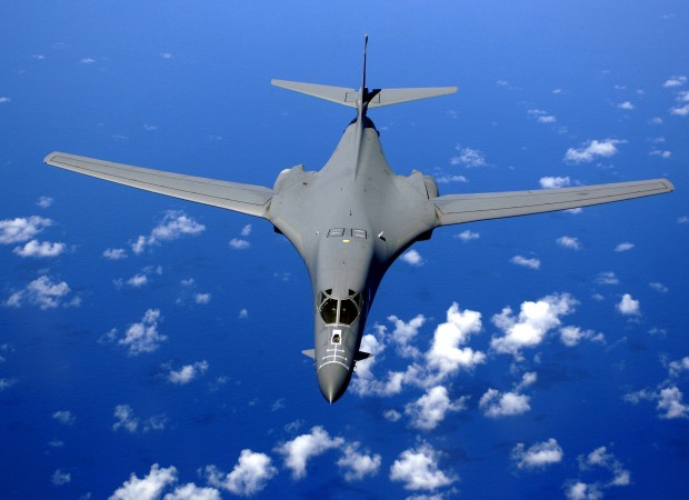 ANDERSEN AIR FORCE BASE, GUAM -- A B-1B Lancer soars over the Pacific Ocean after air refueling training here Sept. 30. The B1B Bomber is deployed to Andersen Air Force Base, Guam, as part of the Pacific Commands continuous bomber presence in the Asia-Pacific region, enhancing regional security and the U.S. commitment to the Western Pacific.  The B1 is from the 37th Bomb Squadron, Ellsworth Air Force Base, South Dakota. (U.S. Air Force Photo by Staff Sgt. Bennie J. Davis III)