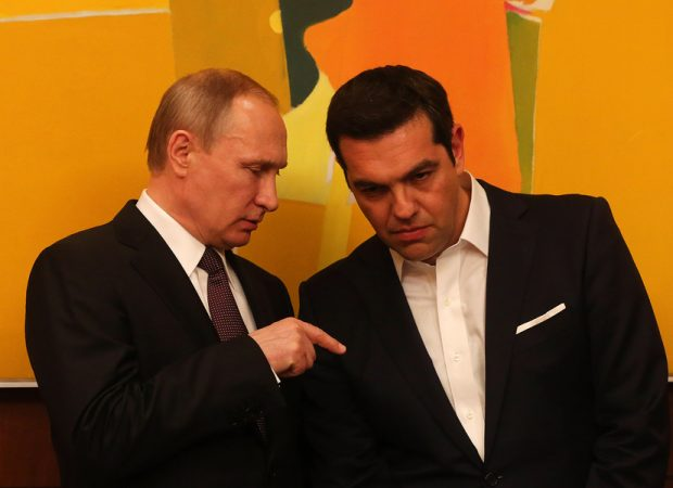 Greek Prime Minister Alexis Tsipras (R) talks with President of the Russian Federation Vladimir Putin (L) during their meeting in Athens on 27 May 2016. VladimirPutin is in Greece on a two days visit. EPA/ANA-MPA/ORESTIS PANAGIOTOU